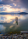 Idaho, North, Kootenai County, Coeur d'Alene. Lake Coeur d'Alene reflects the sky on a peaceful evening in spring.