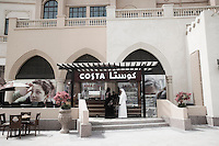 Qatar - Doha - Qataris having drinks at Costa Coffee at The Pearl. The Peal has the most exclusive stores of town, including, Giorgio Armani and Hermes.