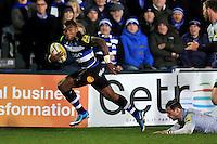Semesa Rokoduguni of Bath Rugby gets past Ben Foden of Northampton Saints. Aviva Premiership match, between Bath Rugby and Northampton Saints on December 5, 2015 at the Recreation Ground in Bath, England. Photo by: Patrick Khachfe / Onside Images