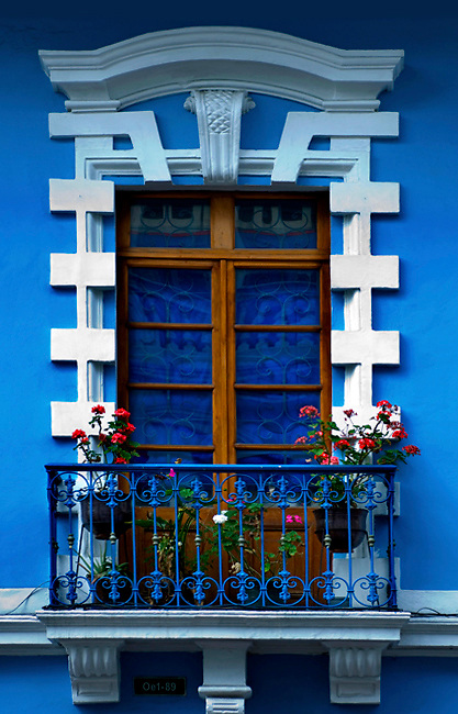 Colorful restored architecture in the historic colonial center of Quito, Ecuador.