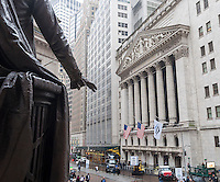 The hand of George Washington in front of Federal Hall waves at the New York Stock Exchange on Wednesday, November 9, 2016, the day after Election Day and Donald Trump's win over Hillary Clinton. Stocks fluctuated after the Republican's win although any uncertainty and trepidation is mitigated by the consensus that Trump will initiate business friendly policies.  (© Richard B. Levine)