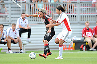 Nick DeLeon (18) of D.C. United goes against Juan Toja (7) of the New England Revolution. D.C. United defeated the The New England Revolution 3-1 in the Quarterfinals of Lamar Hunt U.S. Open Cup, at the Maryland SoccerPlex, Tuesday June 26 , 2013.