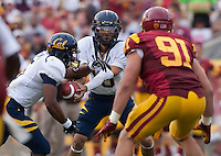 September 22, 2012: California's Zach Maynard hands off the ball to Brendan Bigelow during a game against USC at the Los Angeles Memorial Coliseum, Los Angeles, Ca  USC defeated California 27- 9
