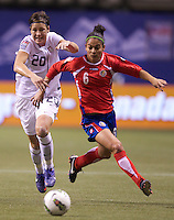 Abby Wambach, left, of the United States and Carol Sanchez of Costa Rica chase down a ball during play in the CONCACAF Olympic Qualifying semifinal match at BC Place in Vancouver, B.C., Canada Friday Jan. 27, 2012. The United States won the match 3-0 to earn a berth in 2012 London Olympics.