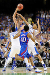 2 APR 2012: Center Jeff Withey (5) from the University of Kansas looks to pass the ball in front of forward Anthony Davis (23) and Michael Kidd-Gilchrist (14) from the University of Kentucky during the Championship Game of the 2012 NCAA Men's Division I Basketball Championship Final Four held at the Mercedes-Benz Superdome hosted by Tulane University in New Orleans, LA. Kentucky defeated Kansas 67-59 to claim the championship title. Ryan McKeee/ NCAA Photos.