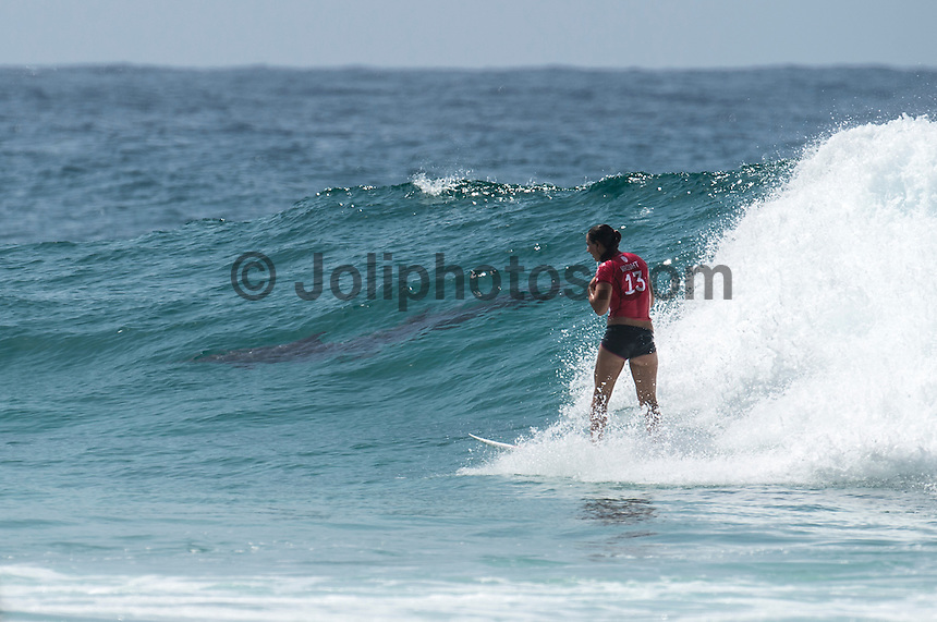 Snapper Rocks COOLANGATTA, Queensland/Australia (Friday, March6, 2015) Carissa Moore (HAW) and dolphins. - Round 3 and Round 4 were completed today in the  Roxy Pro Gold Coast. The event got underway today at 11.30 a.m. local time after being put on hold twice during the morning.<br /> <br /> Quarterfinalists were decided today at the Roxy Pro Gold Coast presented by BOQ, the opening stop on the Samsung Galaxy World Surf League (WSL) Championship Tour. The world&rsquo;s best battled through Rounds 3 and 4 in small, clean surf at Snapper Rocks and the field was narrowed down to just eight surfers.<br />  <br /> Silvana Lima (BRA) delivered the most dominant performance of the Roxy Pro to date, posting the first Perfect 10 of season in her heat against Sally Fitzgibbons (AUS). Despite a blistering start from the Australian with a near-perfect 9.63, the Brazilian unleashed her full repertoire on the Snapper Walls, using her air game and power turns to take her place in the Quarterfinals.<br /> <br /> Chevy Metal, the cover band formed more than a decade ago by Taylor Hawkins (Foo Fighters/The Birds of Satan), played a free show after competition wrapped up. <br /> Featuring Hawkins along with Wiley Hodgden (Bass/Vocals), Chris Shiflett (Guitar) and Rami Jaffee (Keys), Chevy Metal will ripped into some deep cuts off albums by Rolling Stones, Queen, The Police, Black Sabbath, Van Halen and more. Stephan Gilmore (AUS) and Andrew Stockdale (AUS) of Wolfmother famed joined  Chevy Metal on stage.<br /> -  Photo: joliphotos.com