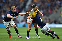 Bernard Foley of Australia is tackled by John Hardie of Scotland. Rugby World Cup Quarter Final between Australia and Scotland on October 18, 2015 at Twickenham Stadium in London, England. Photo by: Patrick Khachfe / Onside Images
