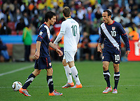 Landon Donovan (10) of USA yells at team-mate Francisco Torres (left). USA tied Slovenia 2-2 in the 2010 FIFA World Cup at Ellis Park in Johannesburg, South Africa on June 18th, 2010.