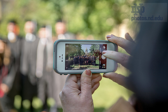 May 15, 2016; Family members take photos of graduates, Commencement 2016. (Photo by Matt Cashore/University of Notre Dame)