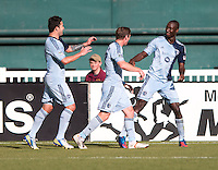 Ike Opara (3) of Sporting Kansas City celebrates his goal with teammates Jacob Peterson (37) and Claudio Bieler (16) during a Major League Soccer match at RFK Stadium in Washington, DC.  D.C. United tied Sporting Kansas City, 1-1.