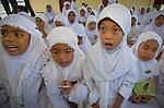 Girls take singing very seriously at Zakiah's pride campaign visit with school kids in Lok Nga village.