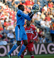 Chicago goalkeeper Sean Johnson (25) pulls down a cross while defender Cory Gibbs (5) looks on.  The Chicago Fire defeated Toronto FC 2-0 at Toyota Park in Bridgeview, IL on August 21, 2011.