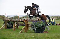 Wolf-Dieter Eckl (GER) and Pennsylvania in the cross country during the FEI Eventing CIC*** at Malmo City Horse Show 2010. <br /> The couple was placed 16th after Friday's dressage, was placed 29th after Saturday's cross country (this pic) and finished as 28th after Sunday's show jumping.<br /> Eventing in Ribersborg, Malmo, Sweden.<br /> August 2010.<br /> Only for editorial use.