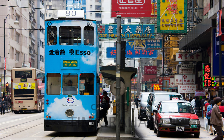 Tram in traditional old Chinese district, Des Voeux Road, Sheung Wan, Hong Kong Island, China