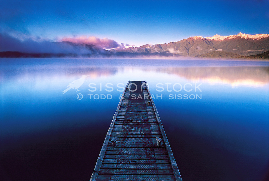 Fiordland Mountains reflected in Lake Hauroko | from the jetty at sunrise, South Island, New Zealand<br /> <br /> NO NEW ZEALAND SOUVENIR OR POSTCARD LICENCING PERMITTED