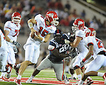 Ole Miss defensive tackle Ted Laurent (99) chases Fresno State's Ryan Colburn (15)  at Vaught-Hemingway Stadium in Oxford, Miss. on Saturday, September 25, 2010. Ole Miss won 55-38.