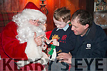 Inter Kenmare FC presents Santas Grotto in the Old Boy School in Kenmare. Pictured is Daniel McCarthy telling Santa his age on his father Denis' lap.