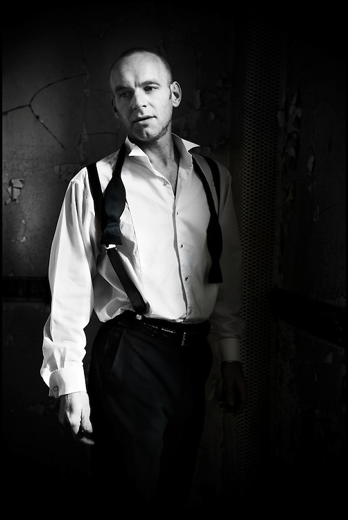 Black and white portrait of Mark on formalwear in West Park abandoned asylum