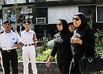 The wife of the Egyptian Prosecutor General killed in bomb attack a day earlier and his daughter Marwa Barakat hold hands before his funeral in Cairo, Egypt, Tuesday, June 30, 2015. Heavy security forces deployed across the Egyptian capital in preparation for the burial of Hisham Barakat, the top judicial official in charge of overseeing prosecution of thousands of Islamists. Photo by Amr Sayed