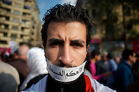 A young egyptian man displays anti military words during a protest in Cairos Tahrir Square.