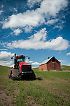 Red tractor and barn in the Palouse Valley
