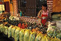 Woman selling produce at the market in Tepoztlan, Morelos, Mexico. Tepoztlan has been designated a pueblo magico or magical town.