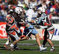 Dave Spaulding (30) of Johns Hopkins steps away from the check Rob Engelke (22) of Princeton during the Face-Off Classic in at M&T Stadium in Baltimore, MD