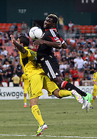 WASHINGTON, DC - AUGUST 4, 2012:  Brandon McDonald (4) of DC United chests the ball down behind Carlos Mendes (4) of the Columbus Crew during an MLS match at RFK Stadium in Washington DC on August 4. United won 1-0.
