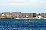 Fishing boat in bay on coast in Maine