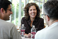 Kathy Cramer Walsh, assistant professor of political science, talks with friends in the Lakefront Cafe in Memorial Union. Cramer Walsh is author of &quot;Talking about Politics: Informal Groups and Social Identity in American Life,&quot; published by the University of Chicago Press in 2003, in which she explores the link between political beliefs and social identity. With Cramer Walsh are assistant professor of political science Jason Wittenberg (left) and associate professor of political science Joe Soss.<br /> <br /> Client: University of Wisconsin-Madison<br /> &copy; UW-Madison University Communications 608-262-0067<br /> Photo by: Michael Forster Rothbart<br /> Date:  7/04    File#:   D100 digital camera frame 5562.