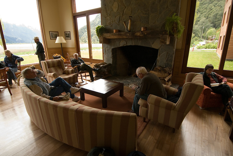 Chile, Lake Country: Hotel Natura in Peulla, scene of fine dining and luxury lodging. Main living room at hotel..Photo #: ch667-33420..Photo copyright Lee Foster www.fostertravel.com, lee@fostertravel.com, 510-549-2202.
