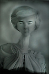 An older woman with a long neck