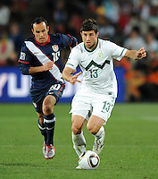 Bojan Jokic of Slovenia races away from Landon Donovan of USA