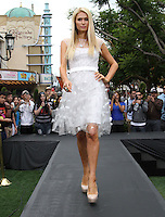 "Paris Hilton .Gabriel Mann And Kathy And Paris Hilton Fashion Show On ""Extra"" Held at The Grove, West Hollywood, California, USA..May 2nd, 2012.full length white sheer dress tulle hand on hip catwalk runway.CAP/ADM/KB.©Kevan Brooks/AdMedia/Capital Pictures."