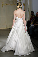 Model walks runway in a Mulberry wedding dress by Carol Hannah Whitfield, for the Carol Hannah Spring Summer 2012 Bridal collection runway show.