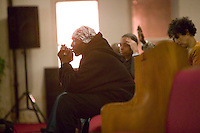New York, USA - Congregation members pray during mass at the Greater Hood Memorial AME Zion Church, home of the Hip-Hop Church, in Harlem, New York, USA, 17 March 2005. Photo Credit: David Brabyn.