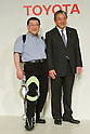 Eiichi Saito, left, a professor in rehabilitation medicine, with the computerized metallic brace strapped onto his left, poses with Toyota executive Yoichi Inoue at a Toyota facility in Tokyo on Tuesday, November 1, 2011, as the auto maker unveiled experimental robots aimed for commercialization from 2013 to the media. Prof. Saito, whose right leg was paralyzed by polio, walked up and down a flight of stairs and showed how the brace could bend at knee as needed, allowing him to walk more naturally. Toyota also demonstrated an intelligent machine with padded arms that can help health care workers lift disabled patients from their beds and then carry them around. Another mobility aid worked like a skateboard to help people relearn balance. (Photo by Natsuki Sakai/AFLO) [3615] -mis-
