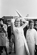 """1965, Jamaica, Queens, New York City, New York State, USA. French actresses Brigitte Bardot and Jeanne Moreau arrive at JFK Airport in New York to promote the film """"Viva Maria"""", directed by Louis Malle. Image by © JP Laffont"""