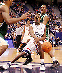 HARTFORD, CT. 02 January 2007-010207SV05--#11 Jerome Dyson of UConn passes under the hoop against South Florida during basketball action at the Civic Center in Hartford Tuesday. <br /> Steven Valenti / Republican-American
