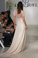 "Model walks runway in a Gilda Bridal gown - champagne beaded sequin gown with prong set stone waist detail and flutter sleeves, from the Anne Bowen Bridal Spring 2013 ""Coat of Arms"" collection fashion show, during Bridal Fashion Week New York April 2012."