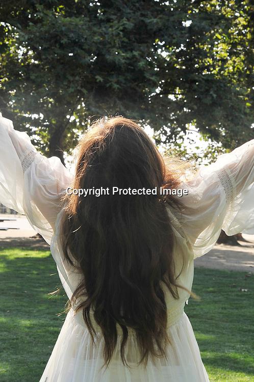 Stock photo of a spiritual woman celebrating nature and dancing