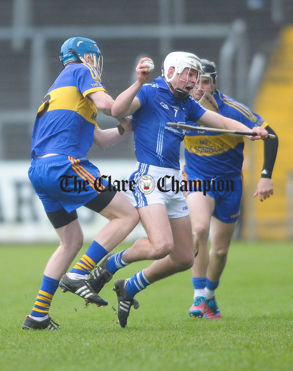 Niall O Connor of Newmarket On Fergus in action against Liam Markham of Cratloe during the senior county hurling final at Cusack Park. Photograph by John Kelly.