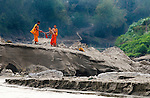 Novice Buddhist monks wash their robes in the Mekong River in Luang Prabang