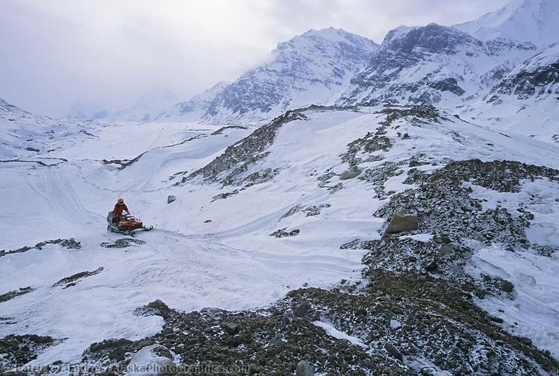 Snow machine, Twaharpies mountains, Twaharpies glacier, Wrangell St. Elias National Park, Alaska.