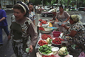 Selling fruit and vegetables in the Chorsu bazaar market, in Tashkent, one of the cities on the old Silk Road trading route through Central Asia. Uzbekistan.