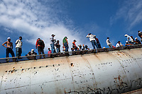 "Dozens of Central American immigrants ride atop a cargo train passing through the border area in the south of Mexico, on 25 May 2010. Between 2010 and 2015, the US and Mexico have apprehended almost 1 million illegal immigrants from El Salvador, Honduras, and Guatemala. While the economic reasons remain the most frequent motivation for people from Central America to illegally immigrate to the US, thousands of Salvadorans, Guatemalans, and Hondurans, many of them minors, seek asylum in the US due to the thriving crime and gang-related violence in their region (known as the Northern Triangle). Taking an exhausting and risky journey, riding thousands of miles atop the cargo trains, facing a physical danger and extortion from the organized crime groups that control migrant routes, the ""undocumented"" still flee to the US, looking for their American dream."