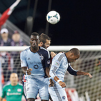 Sporting Kansas City forward C.J. Sapong (17), New England Revolution defender A.J. Soares (5), and Sporting Kansas City forward Teal Bunbury (9) battle for head ball.  In the first game of two-game aggregate total goals Major League Soccer (MLS) Eastern Conference Semifinal series, New England Revolution (dark blue) vs Sporting Kansas City (light blue), 2-1, at Gillette Stadium on November 2, 2013.