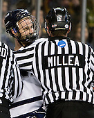 Mike Sislo (UNH - 19), Chris Millea - The Merrimack College Warriors defeated the University of New Hampshire Wildcats 4-1 (EN) in their Hockey East Semi-Final on Friday, March 18, 2011, at TD Garden in Boston, Massachusetts.