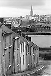 Derry Northern Ireland Londonderry. 1979. The City of Derry from the Waterside area, houses boarded up families moved out of town due to sectarian violence.