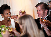 First lady Michelle Obama, left, Governor Bob McDonnell (Republican of Virginia), right, and others raise their glasses for a toast in the State Dining Room of the White House February 26, 2012 in Washington, DC.  President Obama and first lady Michelle Obama hosted 2012 Governors Dinner which coincides with the yearly meeting of the National Governors Association meeting in DC. .Credit: Brendan Smialowski / Pool via CNP
